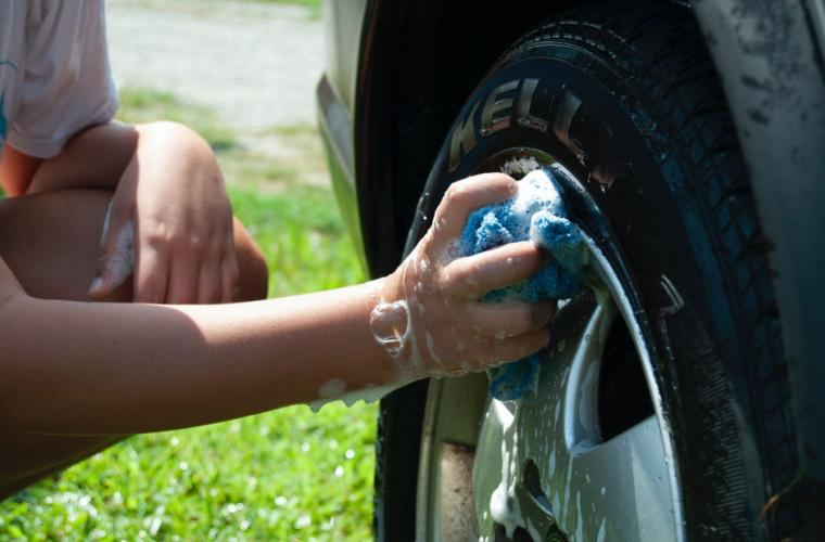 Young person washing a car